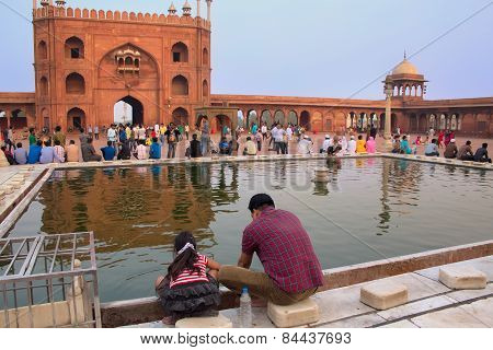 Delhi, India - November 5: Unidentified Man With Unidentified Girl Sits At Jama Masjid On November 5
