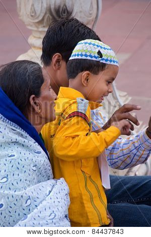 Delhi, India - November 5: Unidentified Woman With Unidentified Boy Sits At Jama Masjid On November