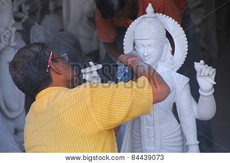 Delhi, India - November 6: Unidentified Man Works  On A Statue At A Workshop On November 6, 2014 In