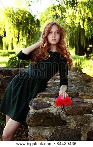 Young Woman With Auburn Hair In The Swamps
