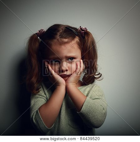 Abandoned Scared Kid With Hands Near Face Looking With Horror