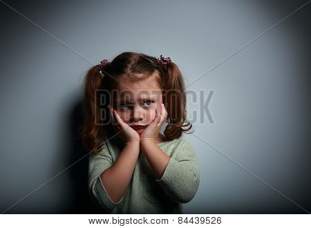 Scared Kid Girl With Hands Near Face Looking With Horror