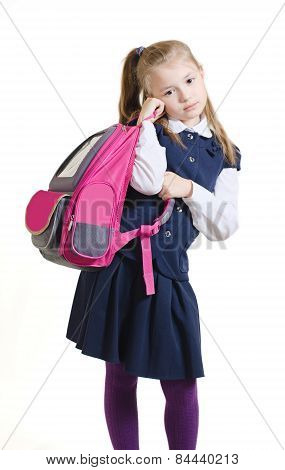 The schoolgirl holds a schoolbag in hand