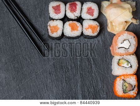 Sushi And Rolls On Black Top View