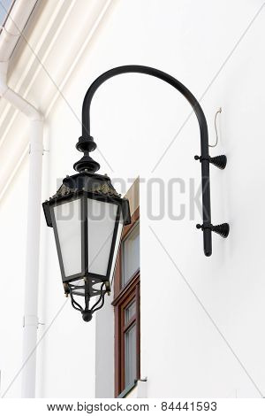 Old Lamp With Windows On Wall.