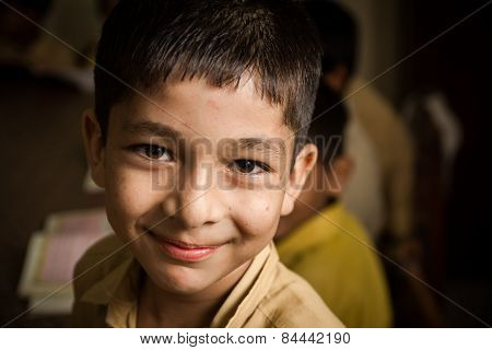 Indian Boy smiling in class