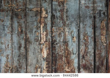 Old damaged wooden wall or fence aged and weathered.