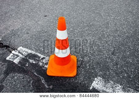 Traffic Cone On The Asphalt Surface.