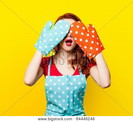 Girl With Oven Gloves And Apron