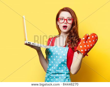 Housewife With Oven Gloves And Computer