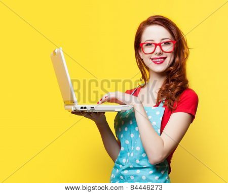 Housewife In Glasses With Computer