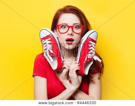 Surprised Redhead Girl In Red Dress With Gumshoes