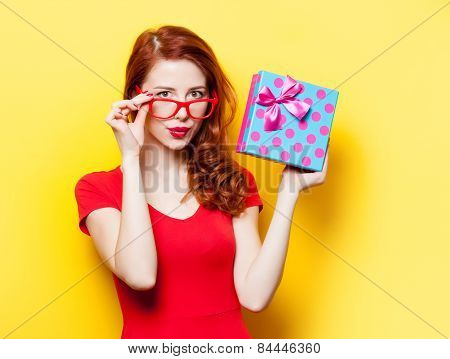 Girl In Red Dress With Glasses And Gift Box