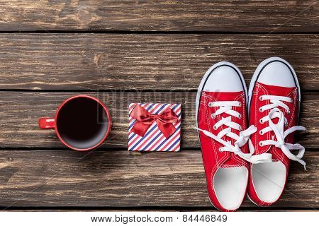 Gumshoes And Cup Of Coffee With Gift