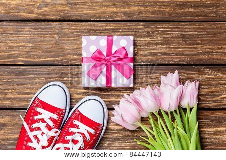 Gumshoes And Gift Box With Tulips