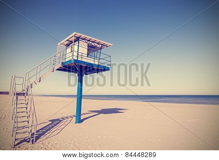 Vintage Retro Style Picture Of A Lifeguard Tower.