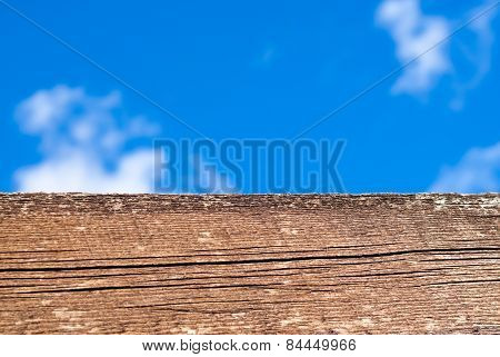 Close-up Of Brown Wood Against Sky
