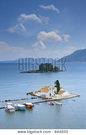 A view of a church and mouse island on Corfu