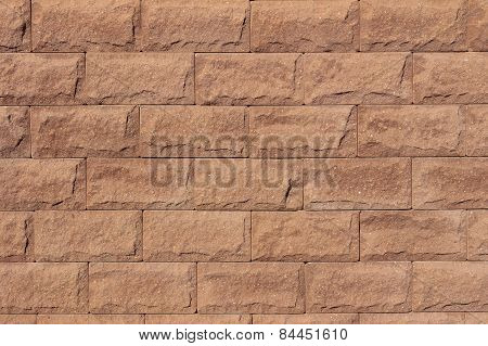 Brown Ragged Wall Of Artificial Stone, Or Tile Seamlessly