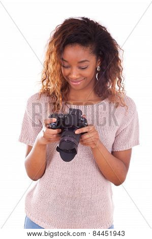 African American Photographer Reviewing Pictures On Her Dslr Camera