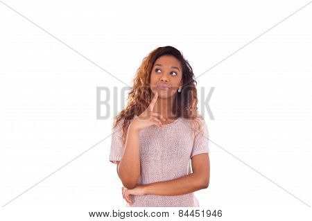 Portrait Of A Thoughtful Young African American Woman Looking Up