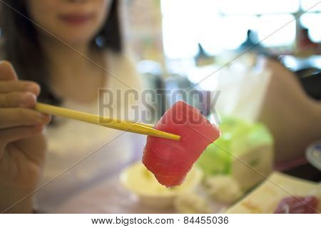 Woman Ready To Eat Sashimi In Restaurant