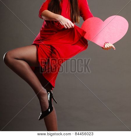 Woman Red Dress Dancing While Holds Heart Sign
