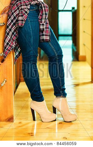Girl Legs In Denim Trousers High Heels Boots