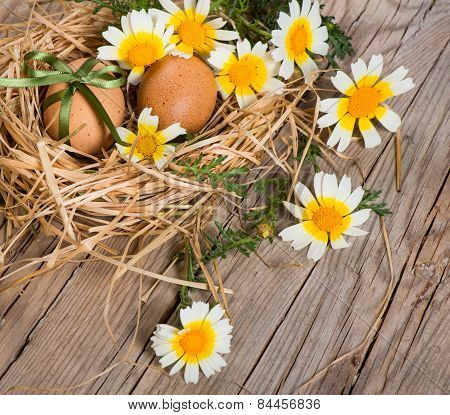 Easter Eggs With Ribbon In A Nest And Flowers