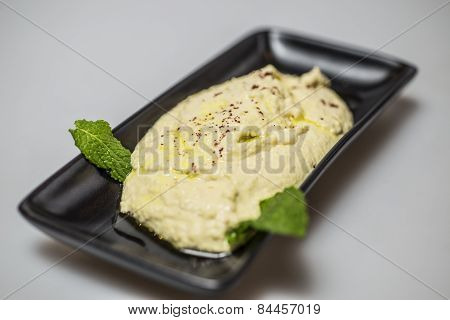 Hummus dip on a plate