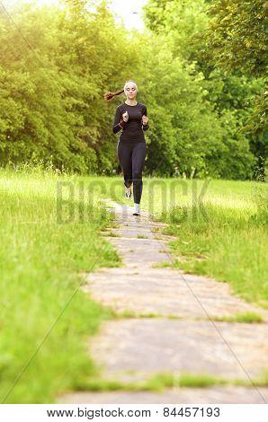 Sports Concept: Positive Sensual Caucasian Sportswoman Running Fast.