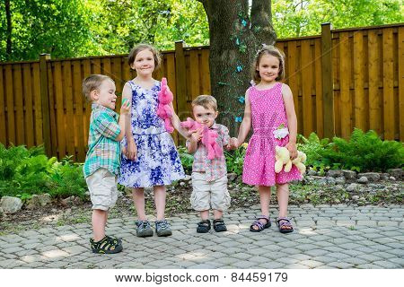 Boys And Girls Holding Hands Together On Easter Day