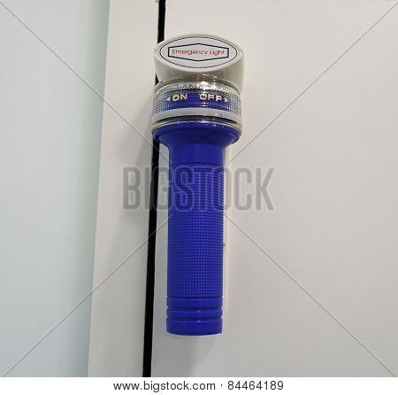 Emergency Flashlight On The Wall
