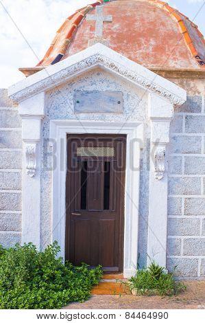 Antique doors at traditional cemetery in Bonifacio, Corsica