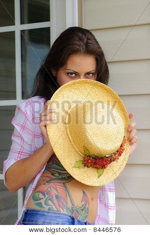 Young Woman Holding Hat
