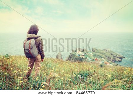 Traveler Woman Looking To The Town On Peninsula
