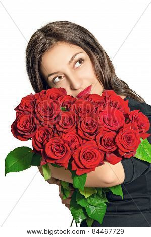 Portrait of a beautiful girl with a bouquet of roses