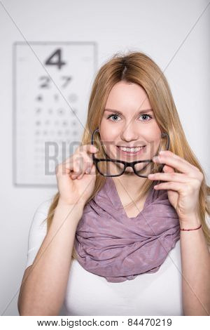 Woman Trying On New Glasses