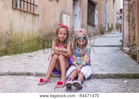 Adorable little girls outdoors in European city
