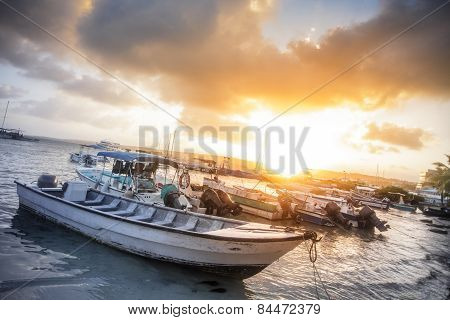 Many Boats On The Beach During Sunset.