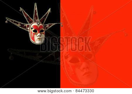 Traditional Venetian Mask On A Black And Red Background