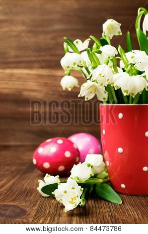 Snowdrops In The Cup And Easter Eggs