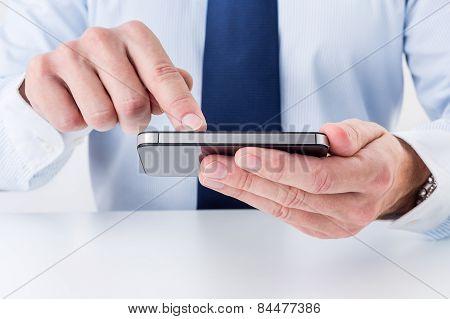 Businessman using smart phone.