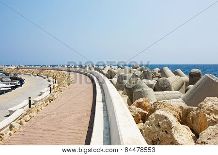 Tetrapods concrete breakwaters in sea marina port.