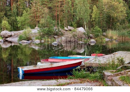 Boat Dock With Wooden Boats