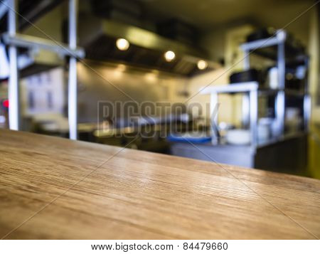 Top of Wooden Table Counter with Blurred Kitchen Restaurant Background