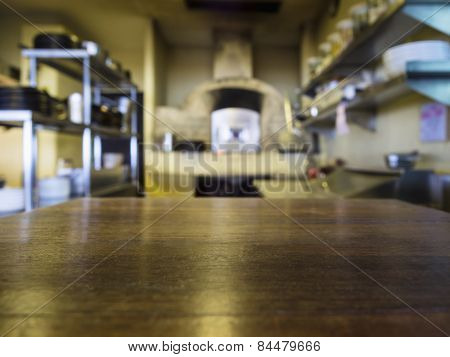 Top Of Wooden Table With Blurred Kitchen Restaurant Background