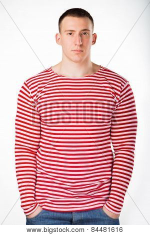 Muscular man in a red striped sweater,