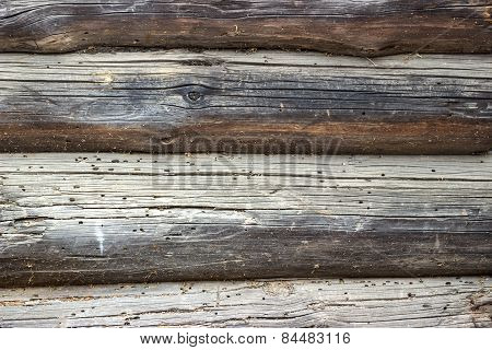 Wooden wall from logs in decline beams