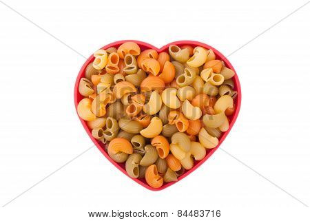 Pasta On The Plate In The Form Of Heart On A White Background.